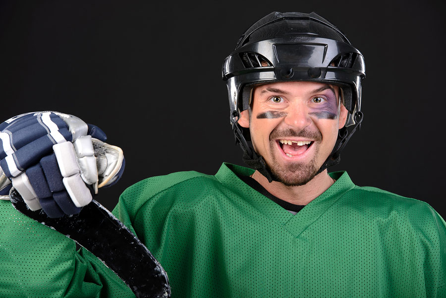 hockey player with a knoced out tooth