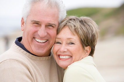 Mature couple posing and smiling
